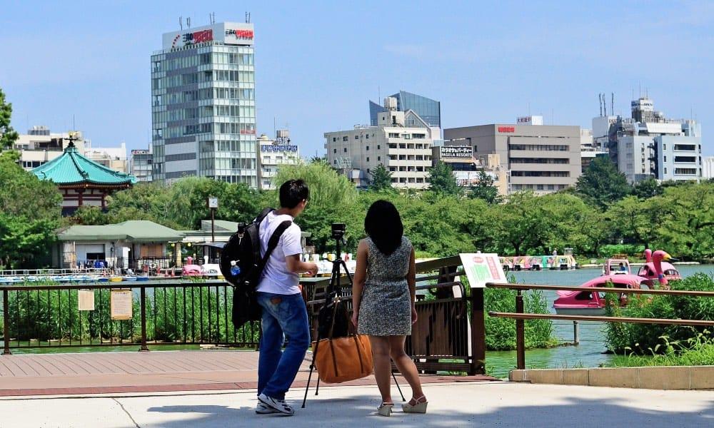 Pareja de viaje Foto Toshihiro Gamo