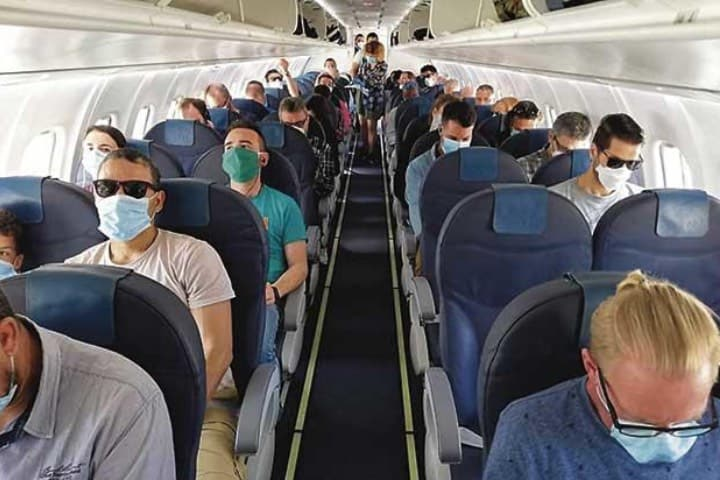 Contraer COVID en avión Foto Archivo