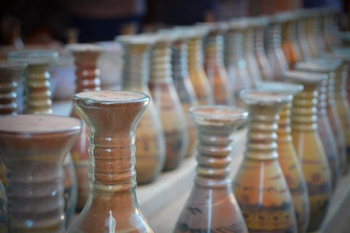 Botellas de arena Foto: Sancho Fotografía