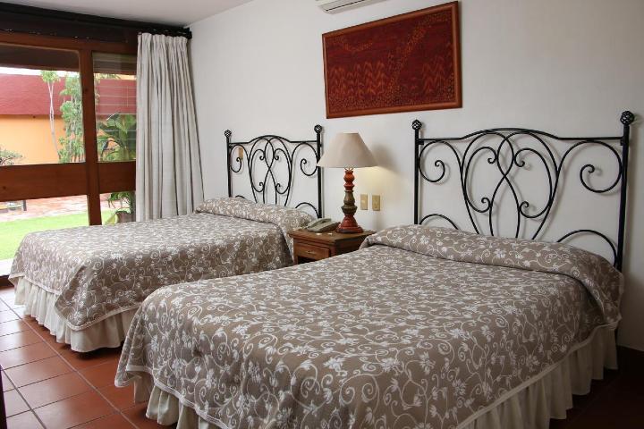 Las habitaciones de la Hacienda de la Noria te esperan. Foto: Booking