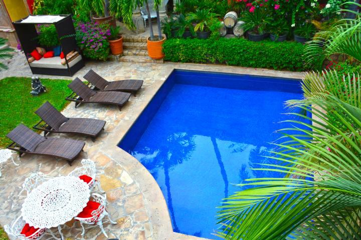 Jardín Foto: Casa Bella Hotel
